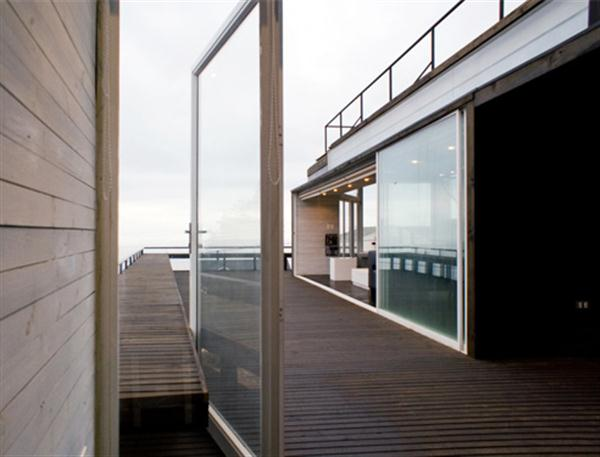 Awesome and Unique Wooden Beach House with big glass door