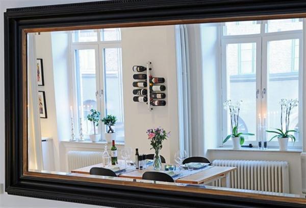 Beautiful Scandinavian Apartment Design by mirror reflection