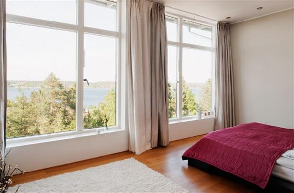 Stylish and Spacious bedroom Design with natural lighting and beautiful view