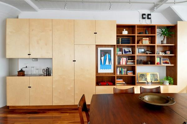 Unique Wooden shelves at creative apartment by ONY Architecture