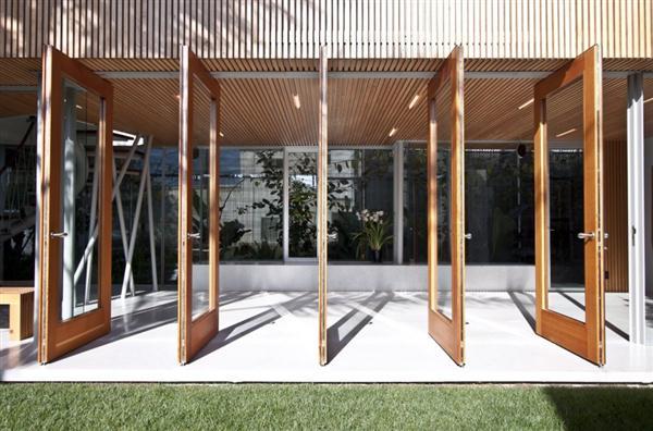 pivoting doors on Modern Home by Bricault Design in Venice California
