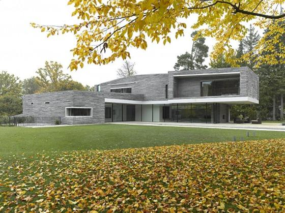 Contemporary Two Story House Design With Rough Stone Facade