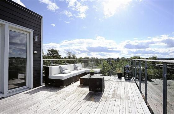 Swedish Style House Design with Black Wooden Exterior Comfortable sofa