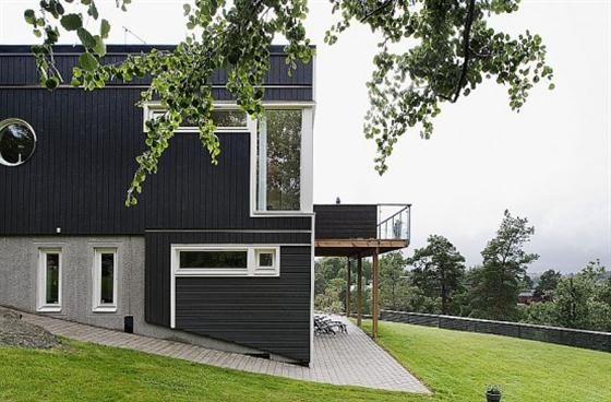Swedish Style House Design with Black Wooden Exterior Side view