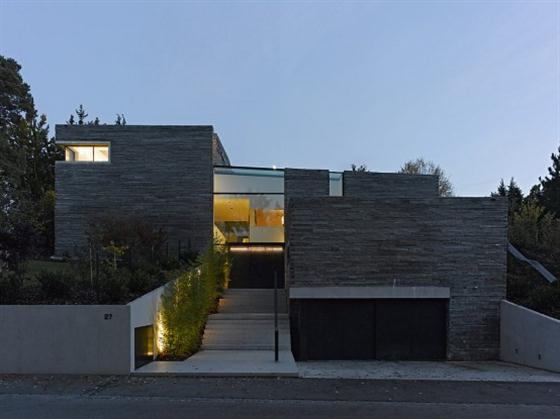 Two Story House Design With Rough Stone Facade Garage