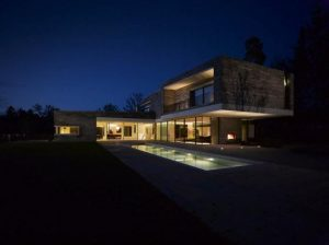 Two Story House Design With Rough Stone Facade Night view