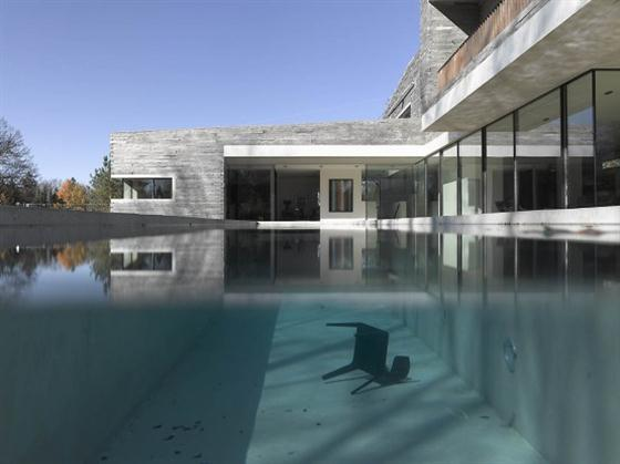 Two Story House Design With Rough Stone Facade Pool