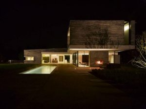 Two Story House Design With Rough Stone Facade night