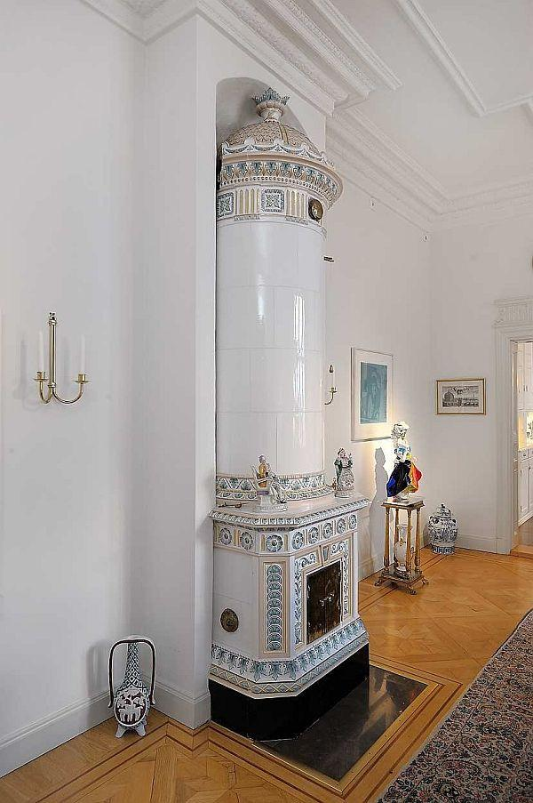 Elegance Apartment Design with Classical and unique fireplaces in Stockholm