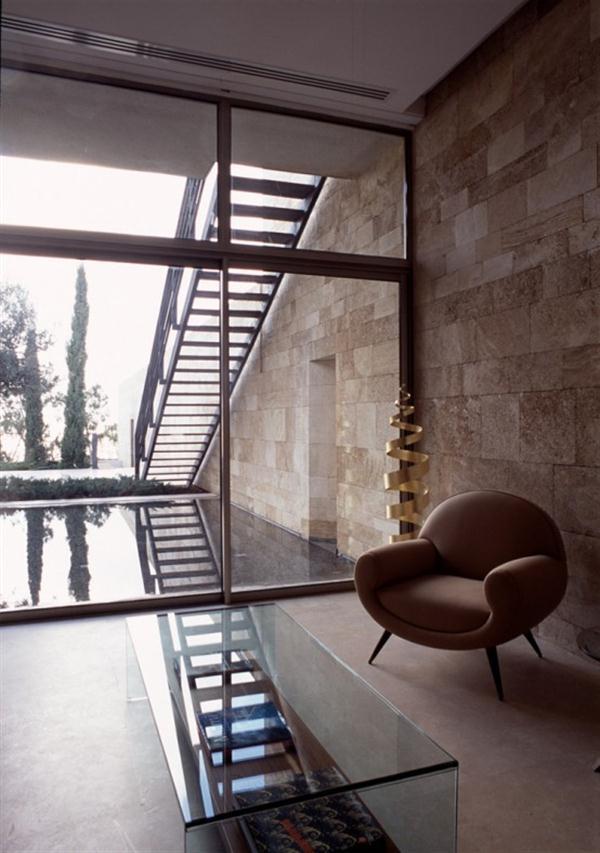 Elegant Mediterranean Home Design with unique corner