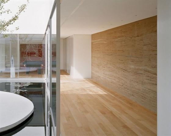 Elegant and Modern White Germany House Design Inside Pond