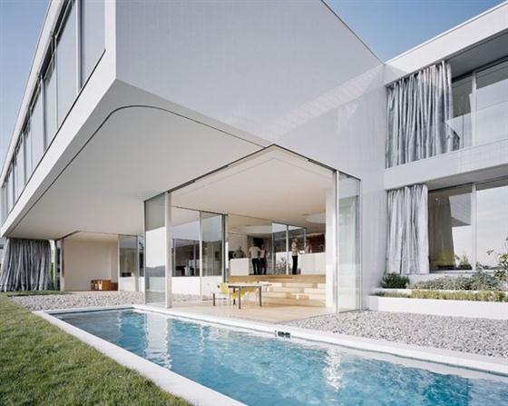 Elegant and Modern White Germany House Design Rear view with Pool