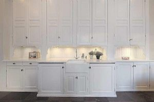 all white kitchen cabinets on Classical Swedish apartement design in Stockholm