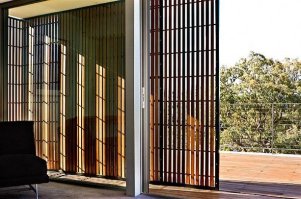 rustic rolling door on the Mosman House by Corben Architects
